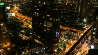 Car trail lights in the Business District at night, Bangkok, Thailand, South East Asia, Asia