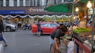 Food stall and traffic on Yaowarat Road, Chinatown, Bangkok, Thailand, Southeast Asia, Asia
