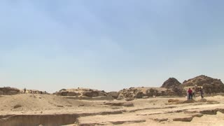 Pan from the desert, Giza Plateau to Pyramid of Khufu the Pyramid of Khafre in background, The Great Pyramid of Giza, Egypt, Africa