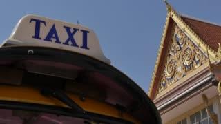 Taxi sign on tuk-tuk and Wat Saket (Golden Mount), Bangkok, Thailand, Southeast Asia, Asia