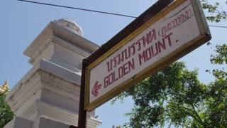 Wat Saket (Golden Mount) and sign, Bangkok, Thailand, Southeast Asia, Asia