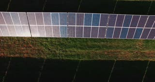 A field filled with solar panels. Horizontal aerial outdoors shot