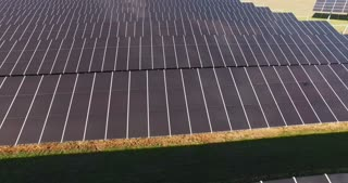 A field filled with solar panels. Horizontal outdoors shot