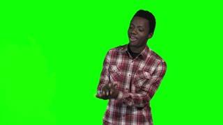 African joyfull guy dancing on green screen