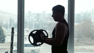 Athlete lifts barbell in gym