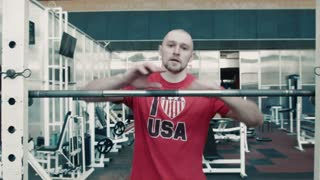 Athlete show thumb up and starting exercise with bar. Lifting heavy weight with bar.