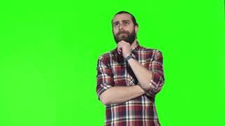 Bearded man wearing VR googles on green screen on background