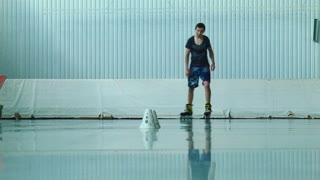 Boy roller freestyle slalom