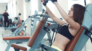 Brunette woman doing chest exercise then drinking water