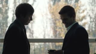 conversation between two businessmen