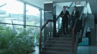 Dialogue of two businessmen on steps