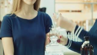Girl chooses perfume in mall