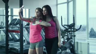 Girls doing selfie in the gym