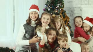 Group of childrens on the background of Christmas tree