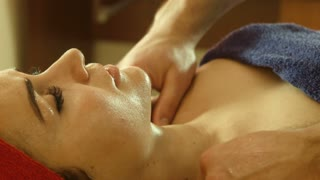 Man doing massage in spa salon