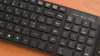 Man presses Enter-on the black keyboard