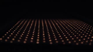 Rows of LEDs on and off the LED lamp light. Slider shot Variable focus on LED lamp close up movement shot of leds lamp with warm light