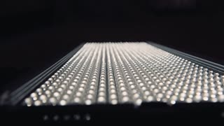 Rows of LEDs on and off the LED lamp light. Slider shot Variable focus on LED lamp close up movement shot