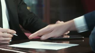 Close shot of hands signing of the contract
