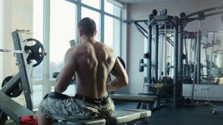 the bodybuilder does exercises for a back