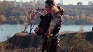 The girl does exercises in autumn park