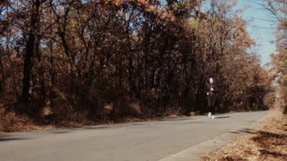 The girl running in autumn park.