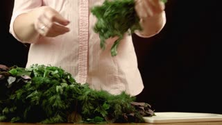 The girl sorts herbs