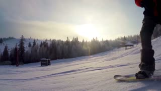 The snowboarder climbs down a mountain
