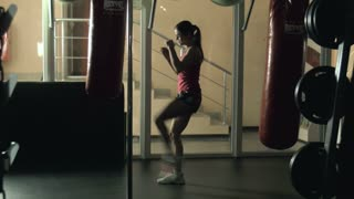 The woman practices boxing
