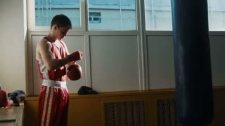 The young boxer training hitting the punching bag