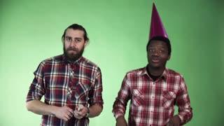 Two diversity man celebrate and dancing using cracker pyrotechnics firework