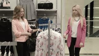 Two girls choose a dress
