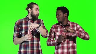 Two multiracial men drinks cola, one a bearded Caucasian and the other a young black guy, upper body isolated on green screen. The looking at camera