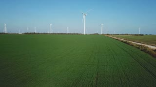 Aerial view of rotating wind turbines
