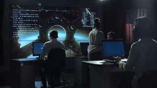 Back view of people working and managing space flight in mission control center. Moon landing of spaceship