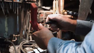 Close view of hands of man repairing old vintage machanical screwdriver