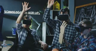 Group of kids with teacher testing VR manipulator in virtual goggles having class. Movement 4K shot on Red cinema camera.