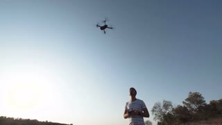 Man learn how to fly and controlling drone on shore