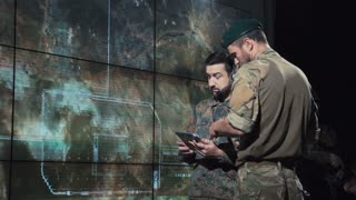 Men in control center calculating coordinates of place of strike to launch nuclear bomb