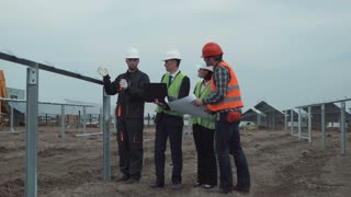 The manager team on a site for mounting the solar energy panels