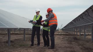 The solar panels project supervisors standing and discussing the plan
