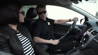 Woman bribing police officer in his car in order to get her driving license back