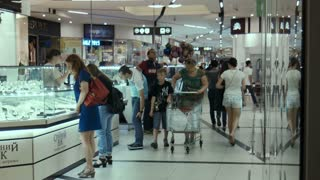 ZAPOROZHYE, UKRAINE - SEPTEMBER 28, 2015: City mall. People go on a trading floor, look at show-windows.