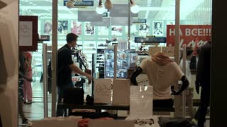 ZAPOROZHYE, UKRAINE - SEPTEMBER 28, 2015: City mall. Timelapse, people go on a trading floor, look at show-windows.