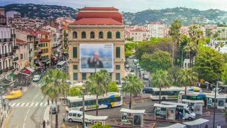 Time lapse of people and traffic in downtown Cannes, France.