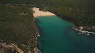 Aerial Australia Sydney Royal National Park Wattamolla Beach April 2018 Overcast Sunny Day 30mm 4K Inspire 2 Prores  Aerial video of Royal National Park at Wattamolla Beach just outside of Sydney Australia on a partially cloudy day.