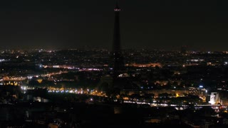 Aerial France Paris Eiffel Tower August 2018 Night 90mm Zoom 4K Inspire 2 Prores  Aerial video of the Eiffel Tower at night with a zoom lens in Paris France. Eiffel Tower with blue sparkling lights.