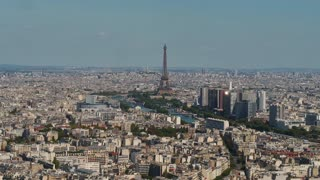 Aerial France Paris Eiffel Tower August 2018 Sunny Day 90mm Zoom 4K Inspire 2 Prores  Aerial video of the Eiffel Tower on a sunny day with a zoom lens in Paris France.