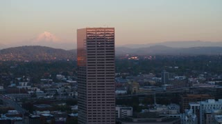 Aerial Oregon Portland NW Downtown November 2017 Dusk 90mm Zoom 4K Inspire 2 Prores  Aerial video of Big Pink U.S. Bancorp Tower in Portland with Mt Hood in background.