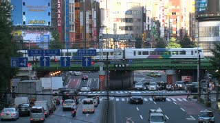 A busy crossing at Shinjuku one of the 23 special wards of Tokyo, Japan with trains and cars